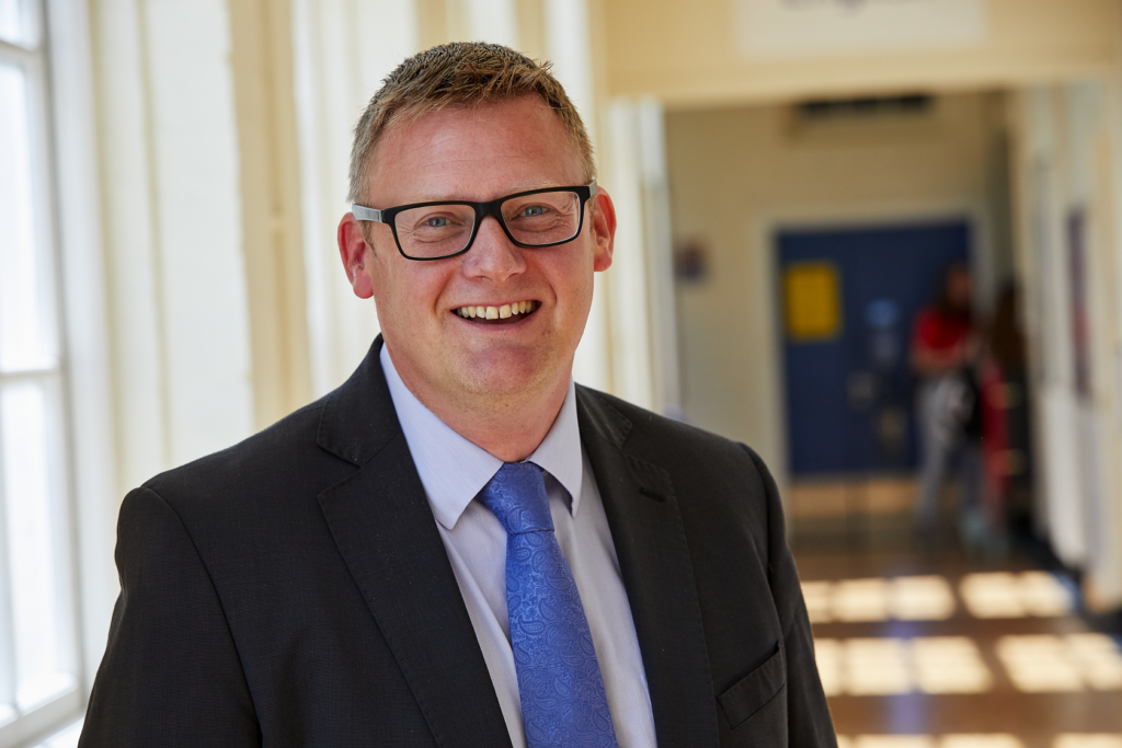 photo of WQE headmaster Paul Wilson in school corridor